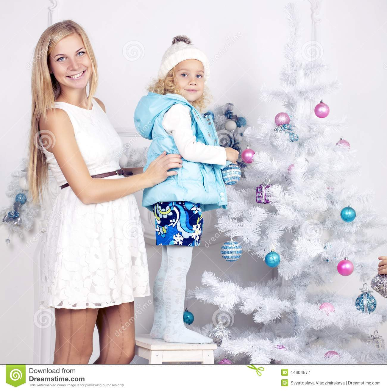 Little Girl Christmas Tree: Cute Little Girl With Her Mom Decorating Christmas Tree