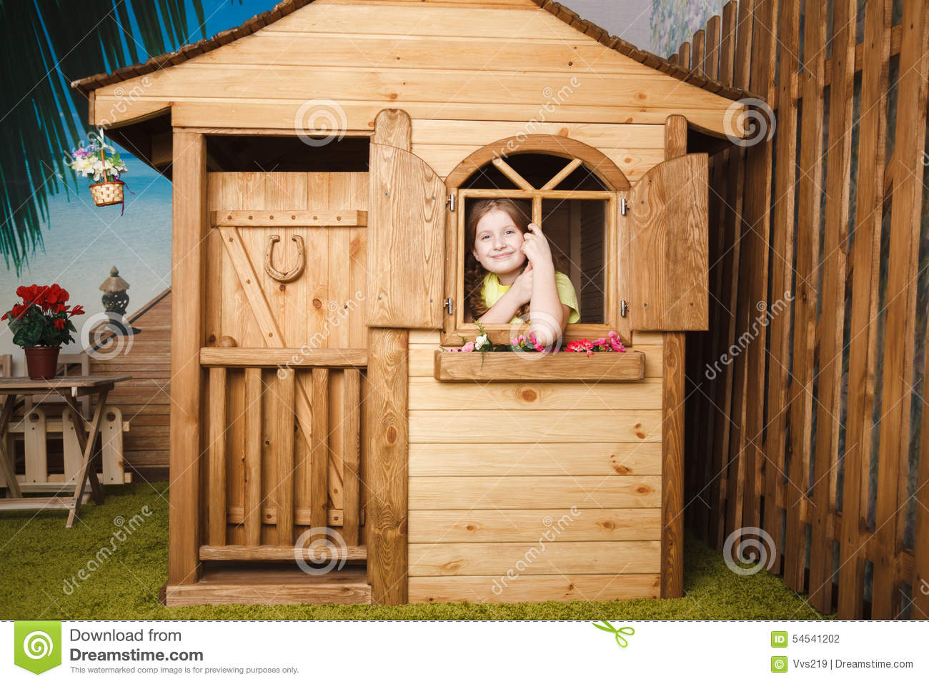Cute little girl inside wooden house stock photo image for Cute houses inside