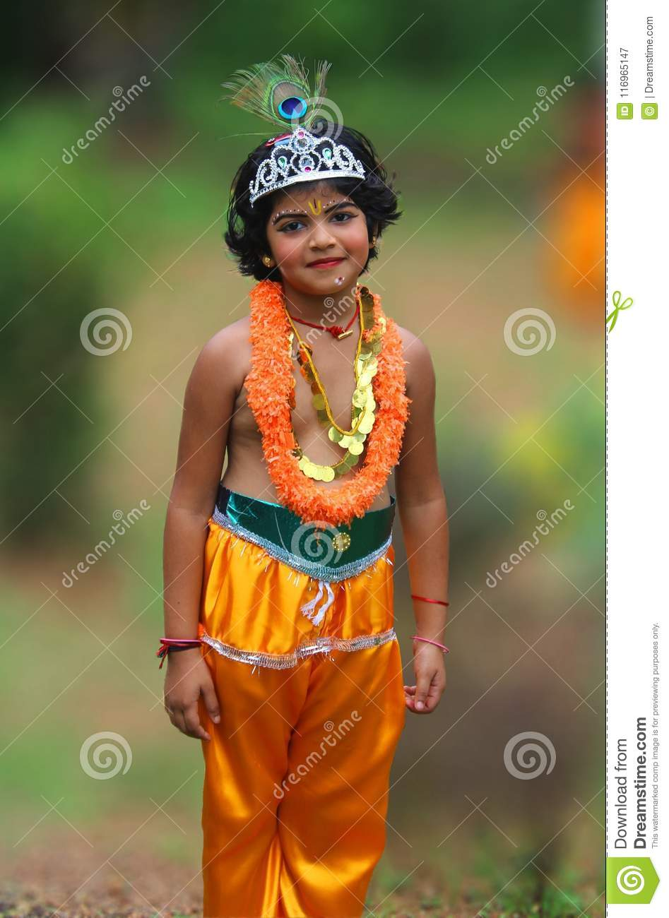 a cute little asian girl dressed as lord krishna editorial