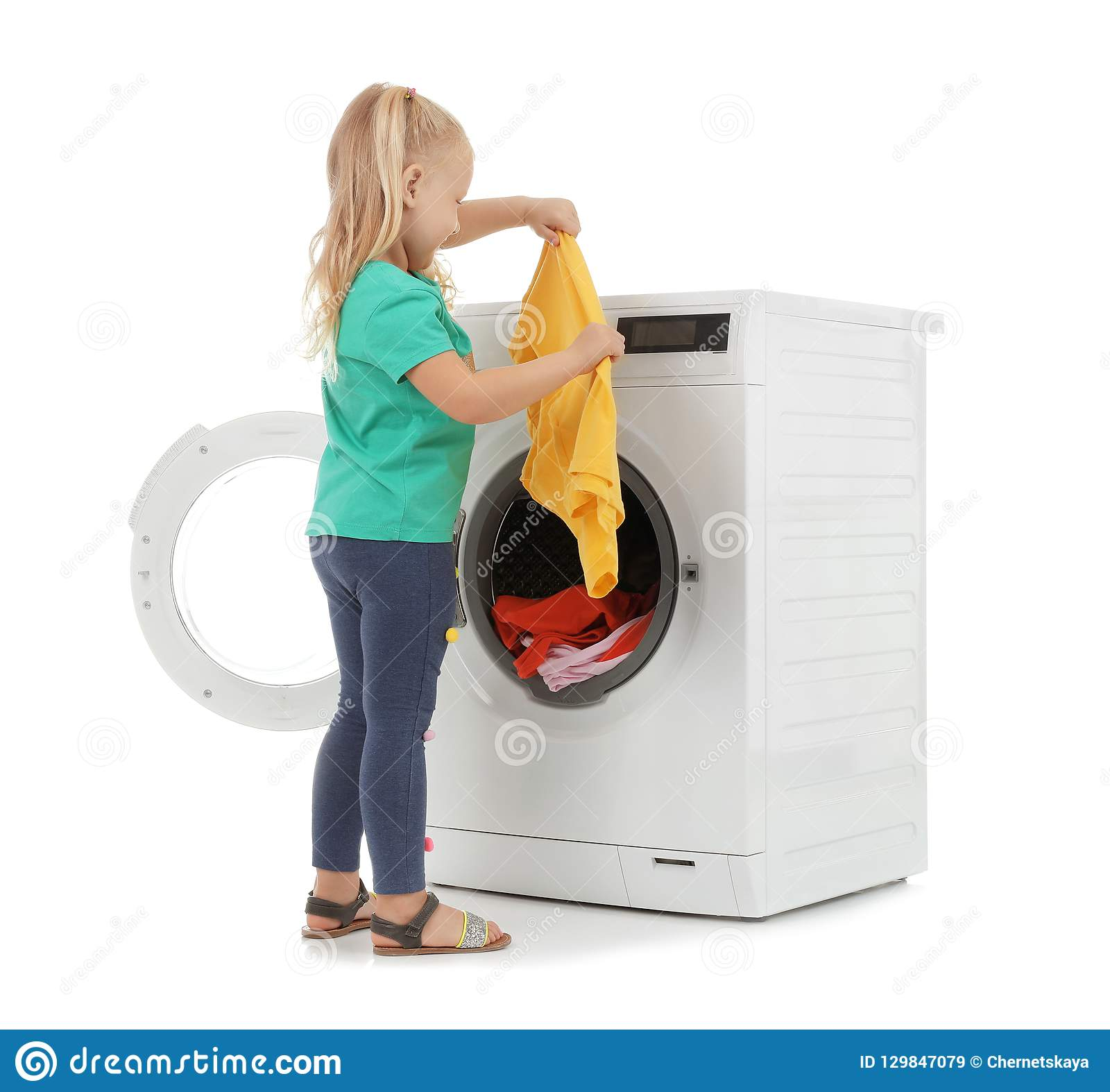 Cute Little Girl With Laundry Near Washing Machine Stock ...