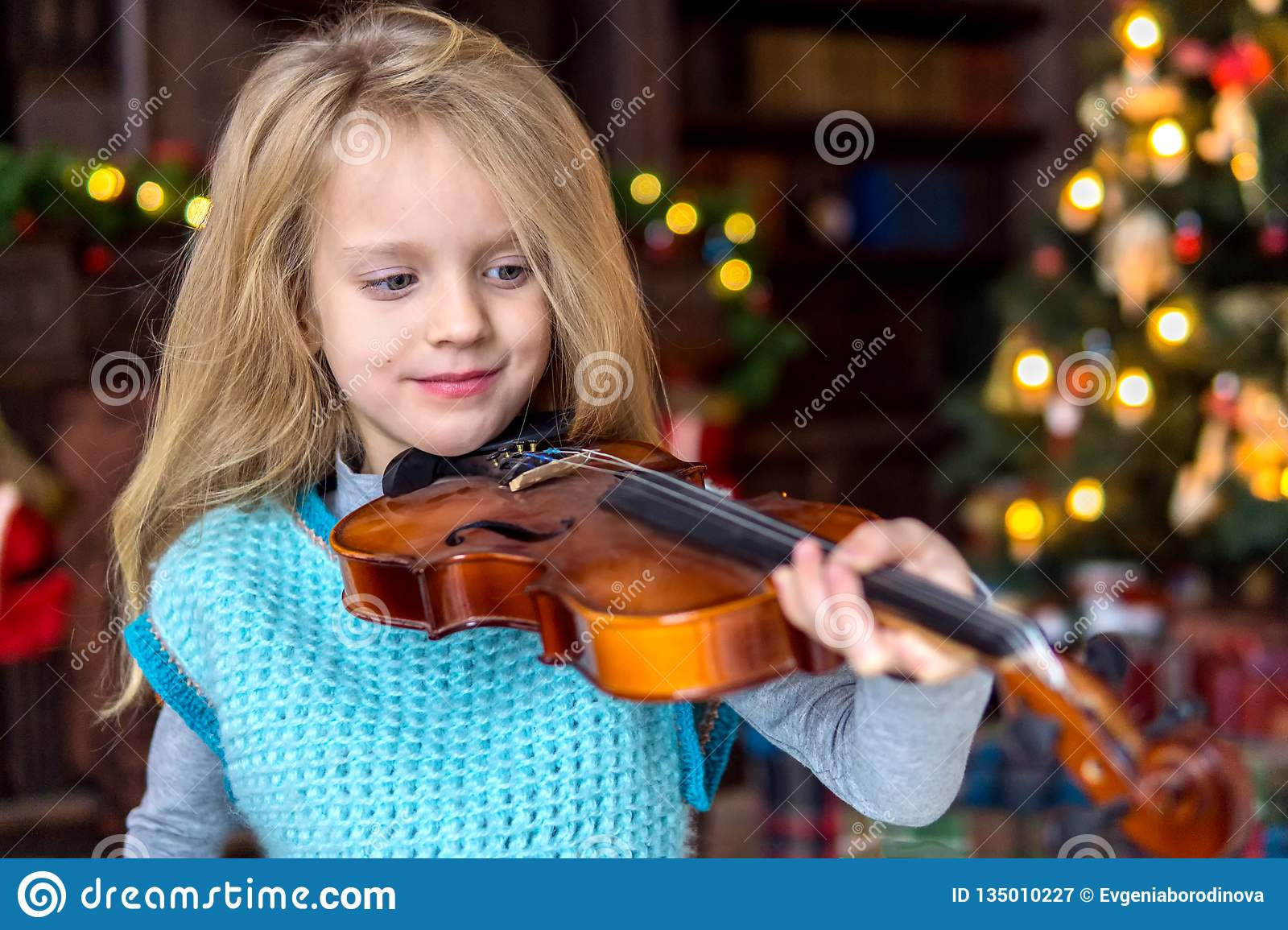 Cute Little Girl Learning To Play Violin Stock Image - Image