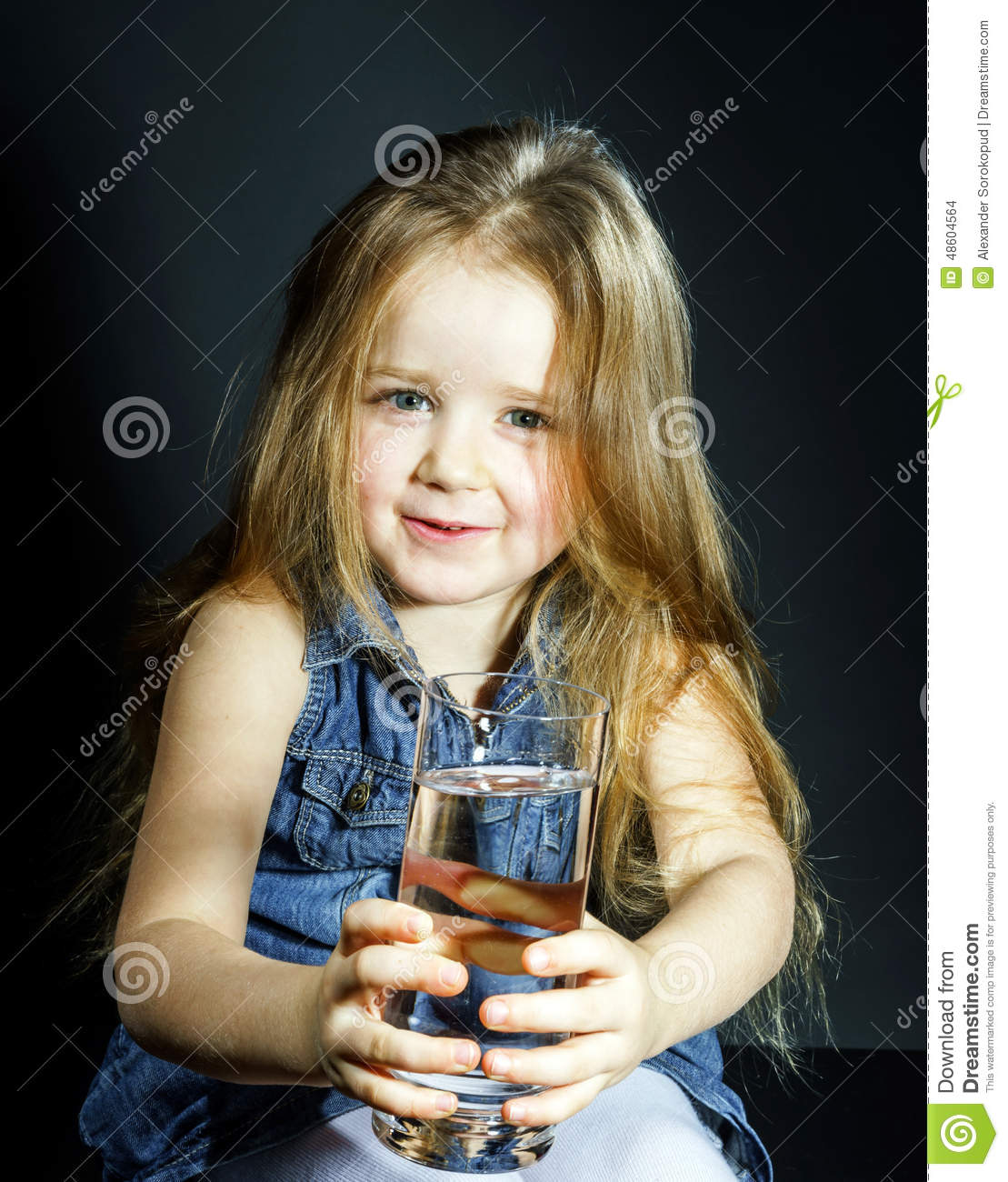 Cute Little Girl With Long Hair Holding Glass Of Water Stock Photo