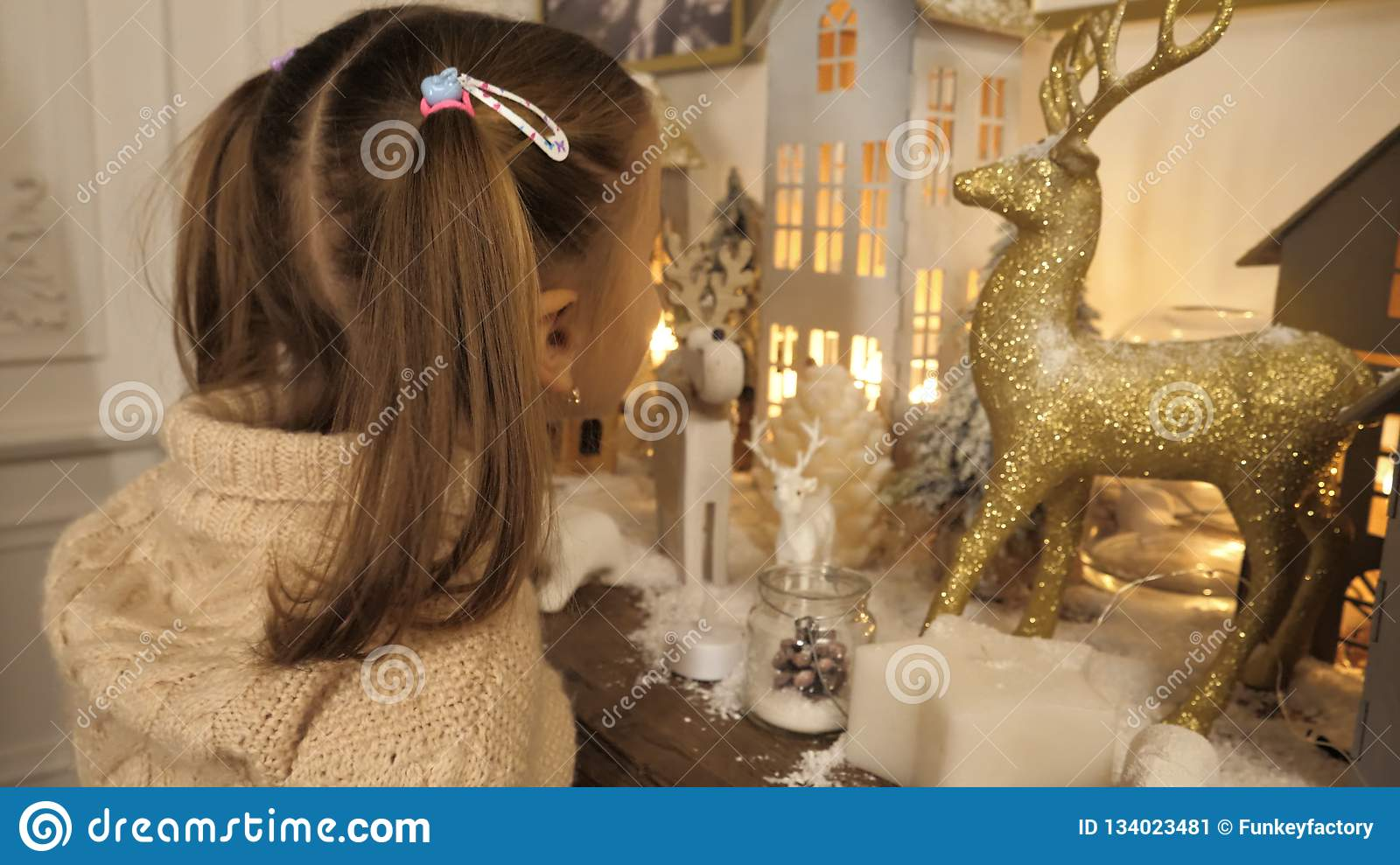 Cute little girl looking at christmas decorations.