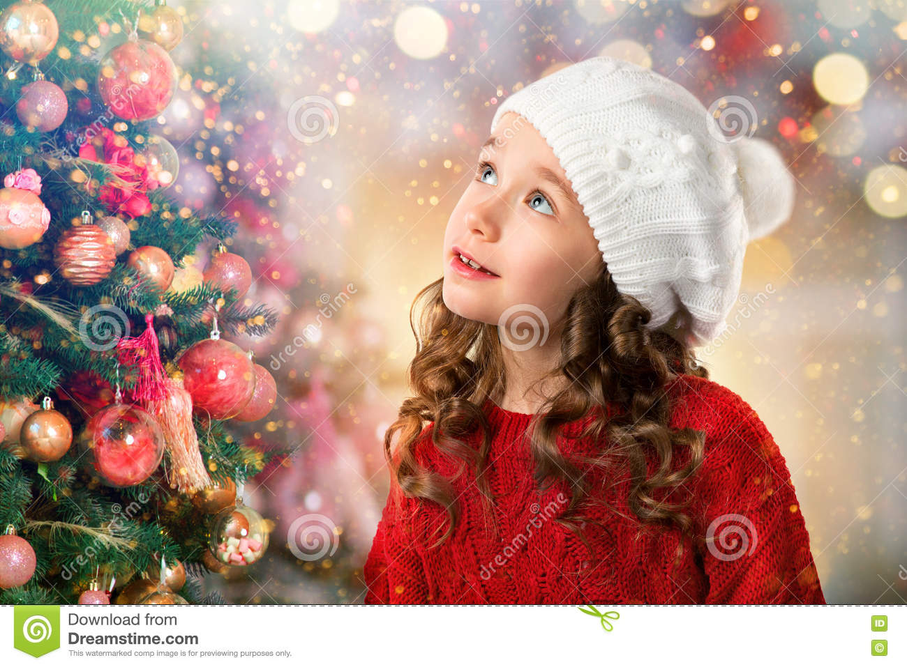Cute Little Girl With A Christmas-tree Ball Stock Image