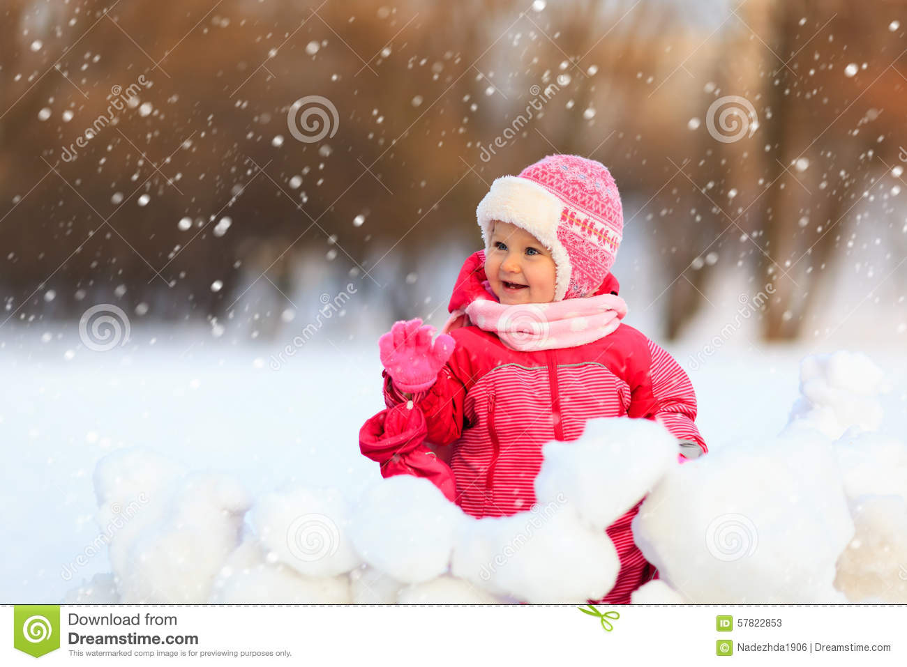 cute little girl play in winter snow stock image - image of january