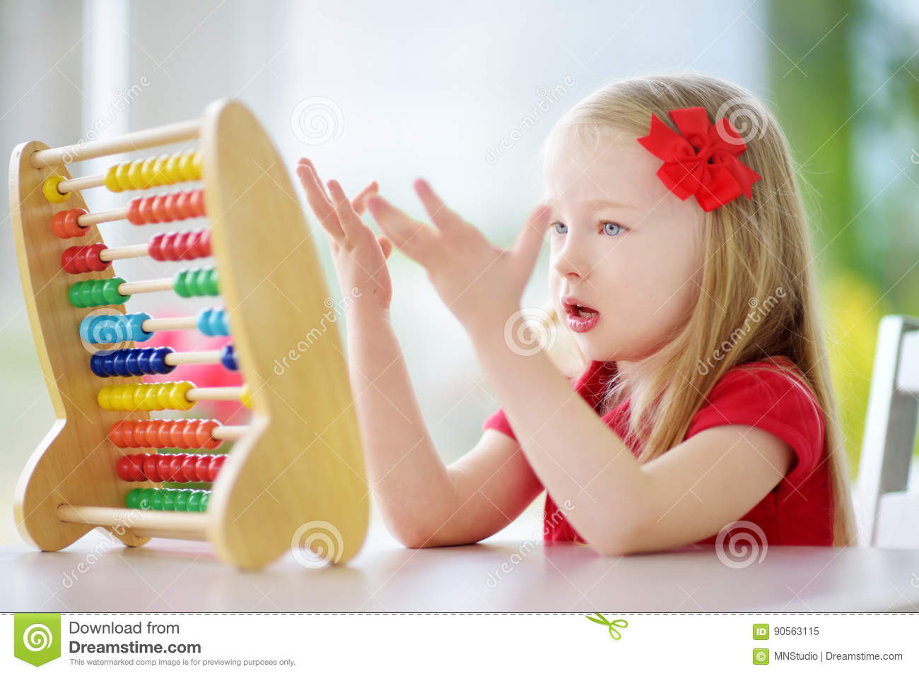 Cute Little Girl Playing With Abacus At Home. Smart Child ...