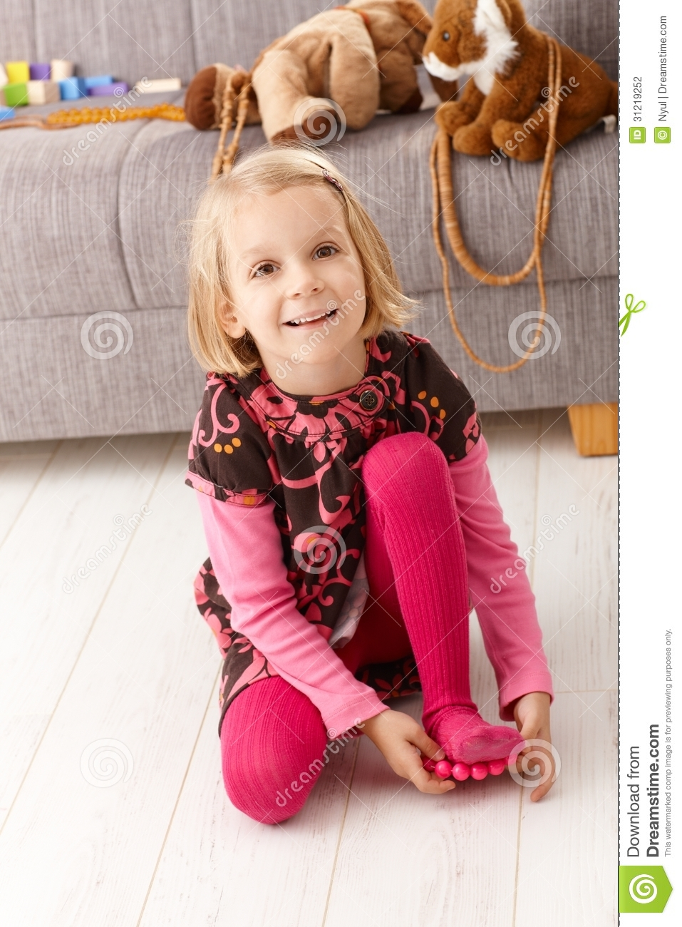 Cute Little Girl Playing At Home On Floor Smiling Stock