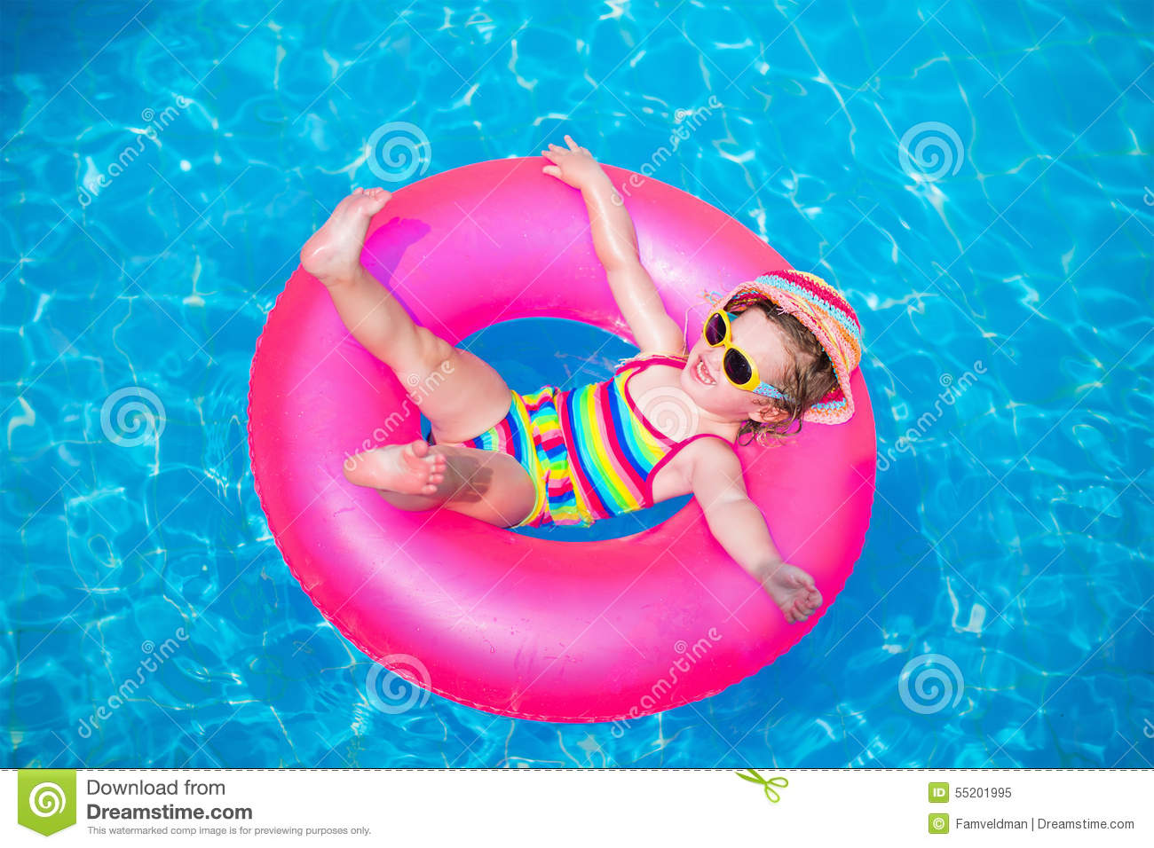 Cute Little Girl Playing In Swimming Pool Stock Photo