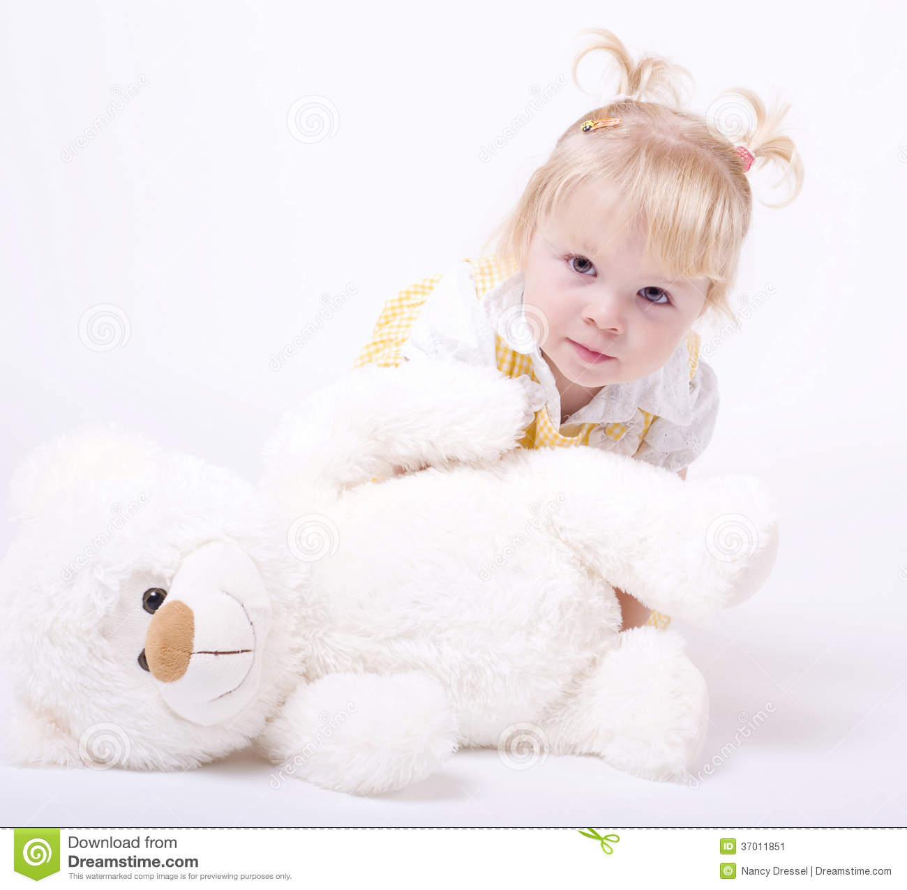 Adorable Little Girl Playing With Beach Toys During: Cute Little Girl Playing With Teddybear Stock Image