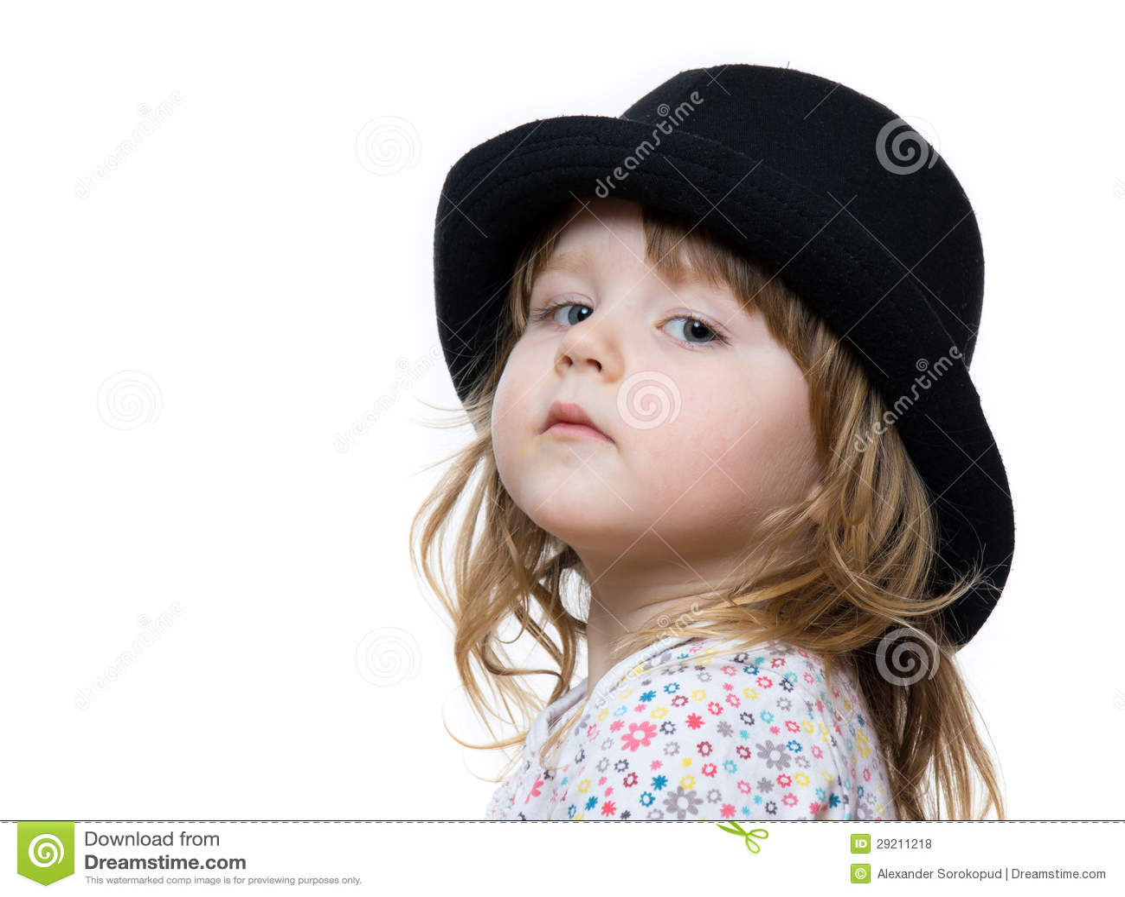 Cute little girl posing in black hat