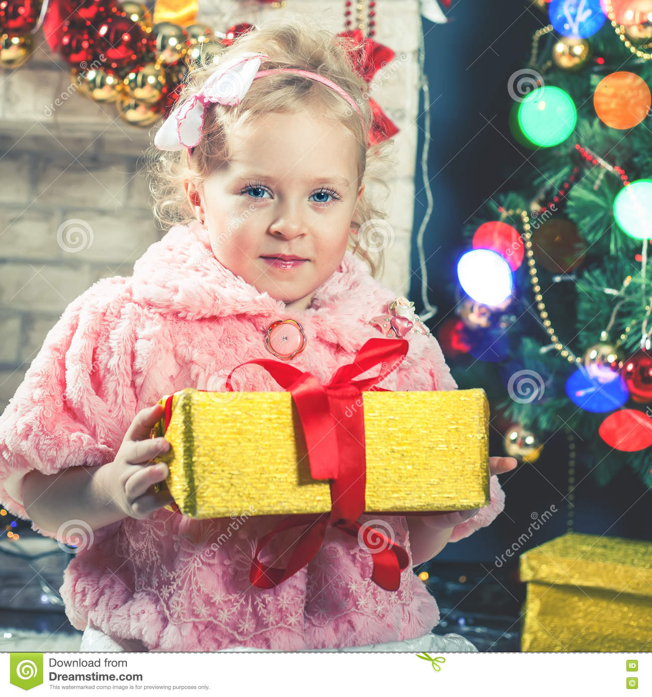 Little Girl Christmas Tree: Cute Little Girl Receive A Gift Near Decorating Christmas
