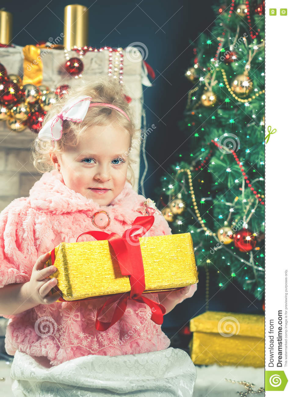 closeup image of happy little girl receive a gift near decorating christmas tree new year 2017 fairy tale dressed in fashion fur coat