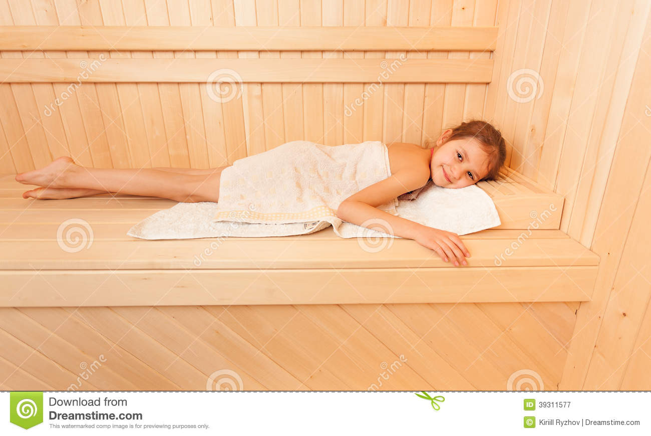 Cute Little Girl Relaxing On Bench At Sauna Stock Photo