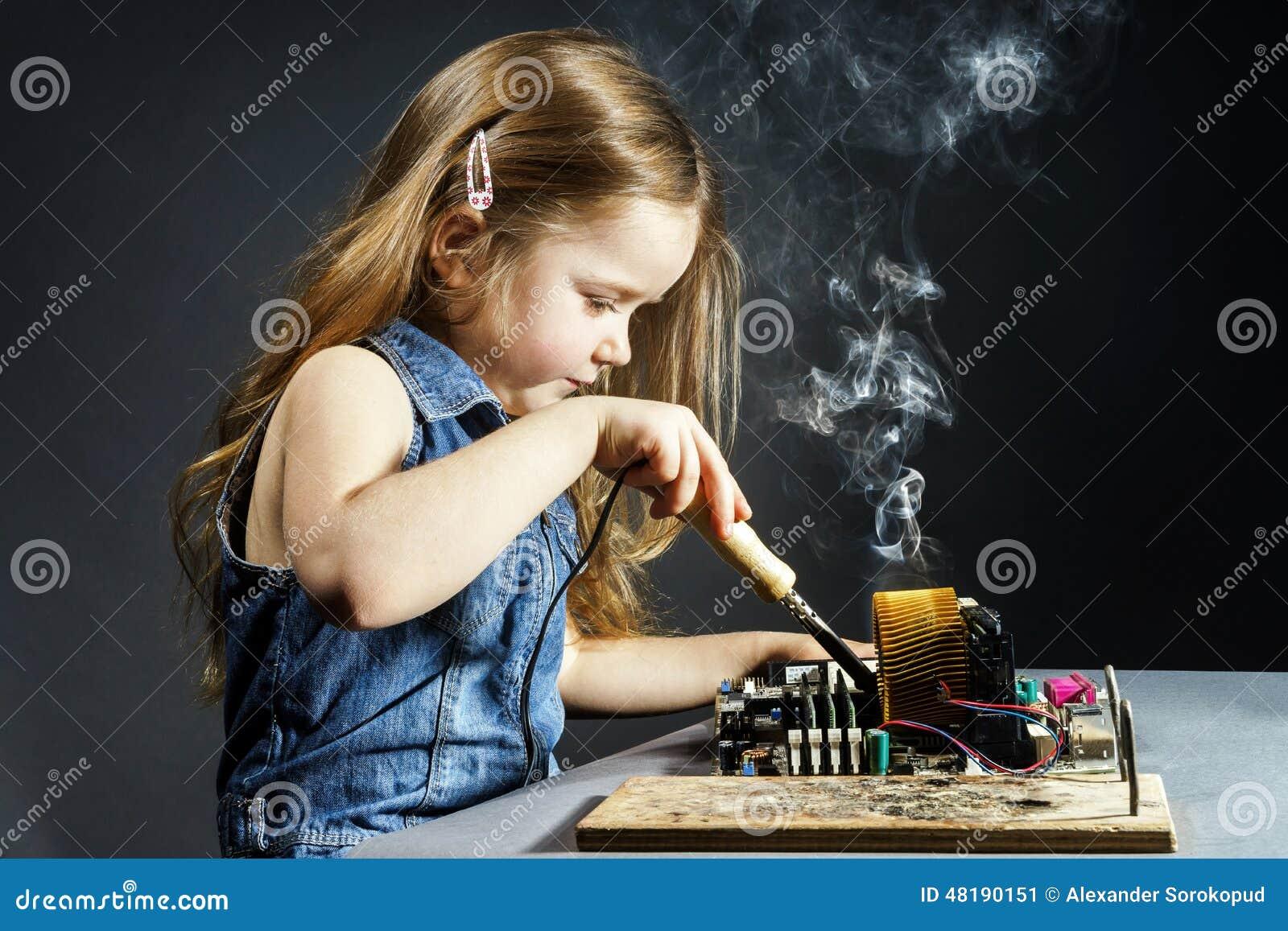 Cute Little Girl Repair Electronics By Cooper-bit Stock ...