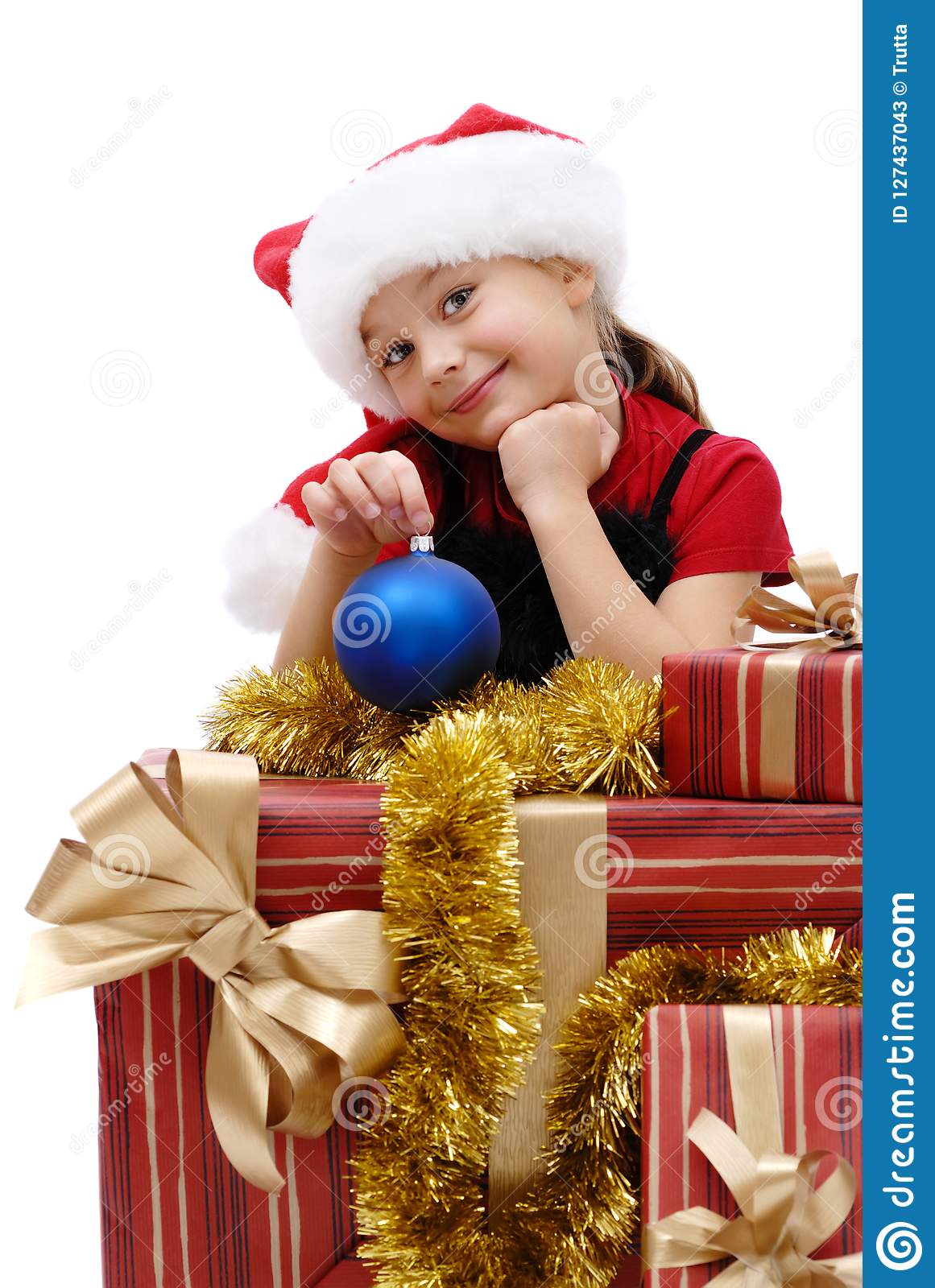 889876d0a Cute little girl in a Santa Claus cap with Christmas gifts on a white  background, isolated