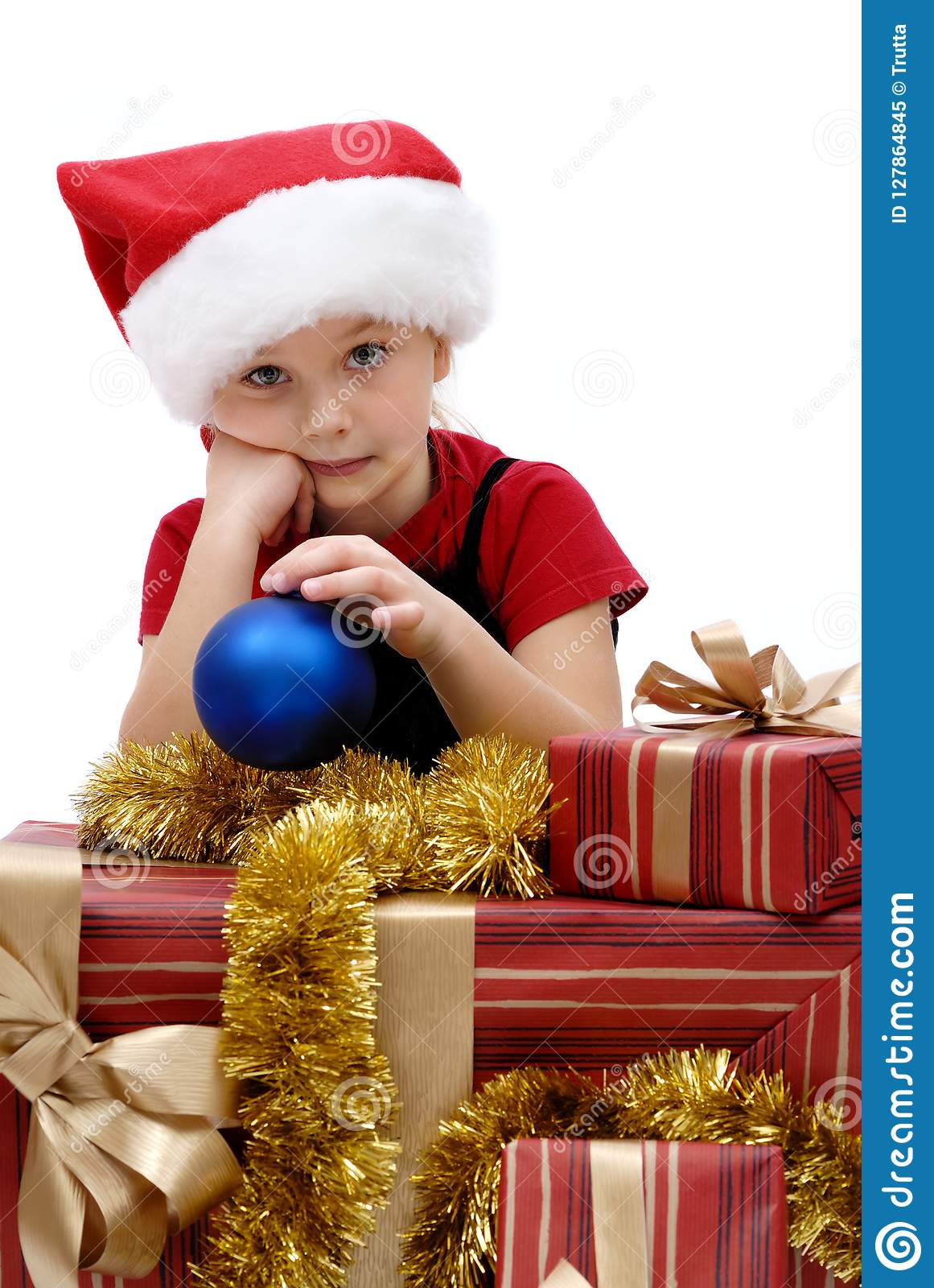 Cute Little Girl In A Santa Claus Cap With Christmas Gifts, Isol ...