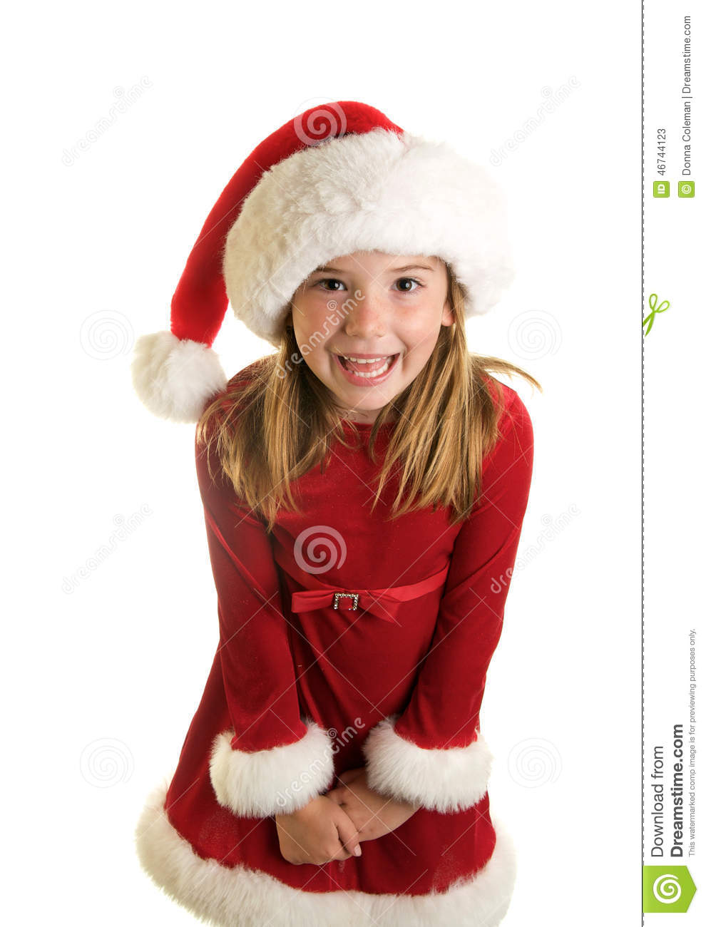 A Cute Little Girl In A Santa Claus Hat And Christmas Dress Stock