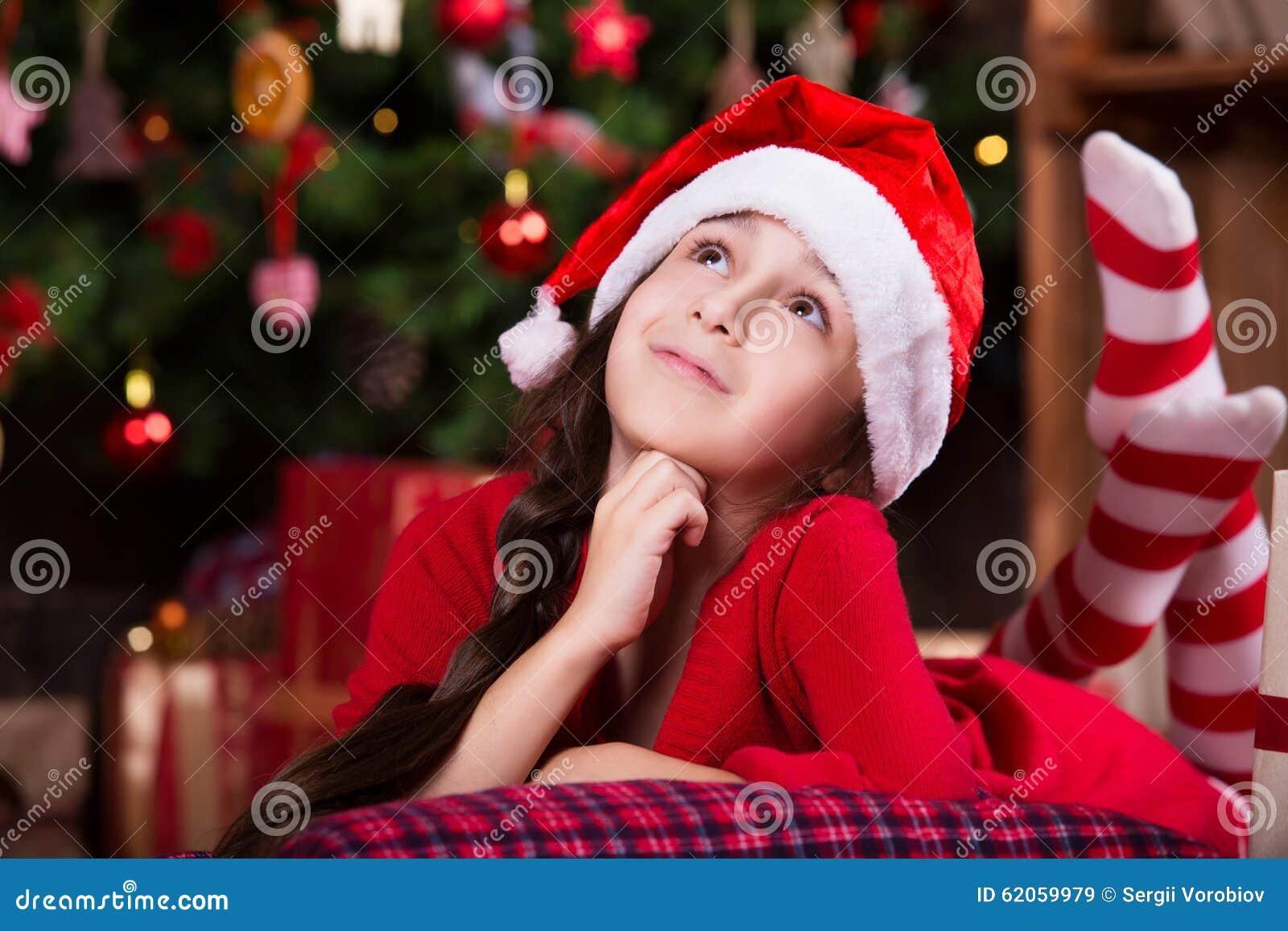 3a0da129415c8 Cute Little Girl In Santa Hat Dreaming Near The Stock Image - Image ...