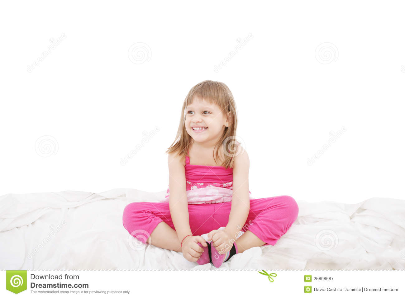 cute little girl sitting on the bed royalty free stock