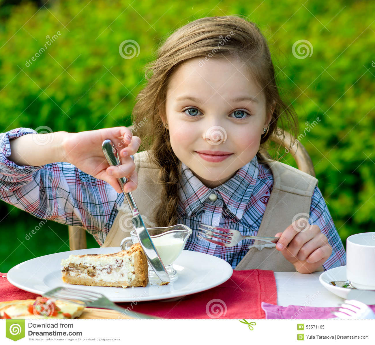 Cute little girl sitting by dinner table and eating stock photo image 55571165 - Stylish cooking ...