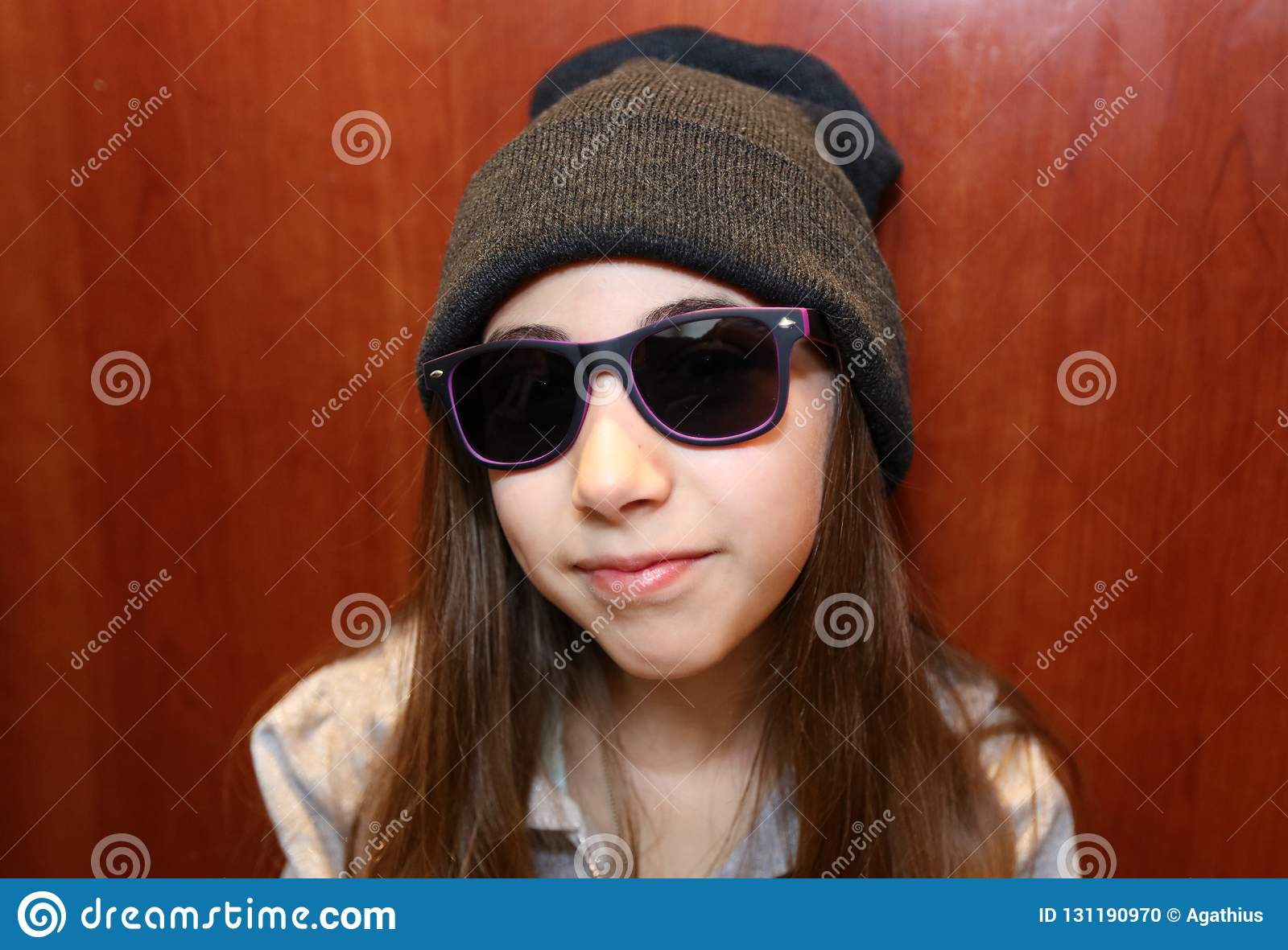 Cute little girl smiling wearing white and black sunglasses