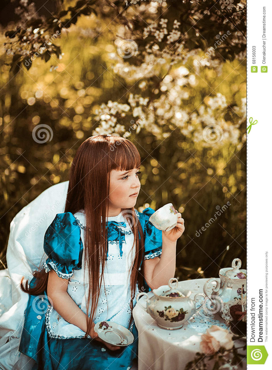Cute Little Girl In A Spring Garden Drinking Tea Stock Image - Image ...