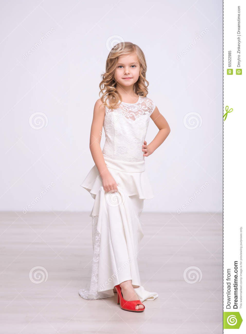 Cute Little Girl Standing In A Wedding Dress Stock Image - Image of ...