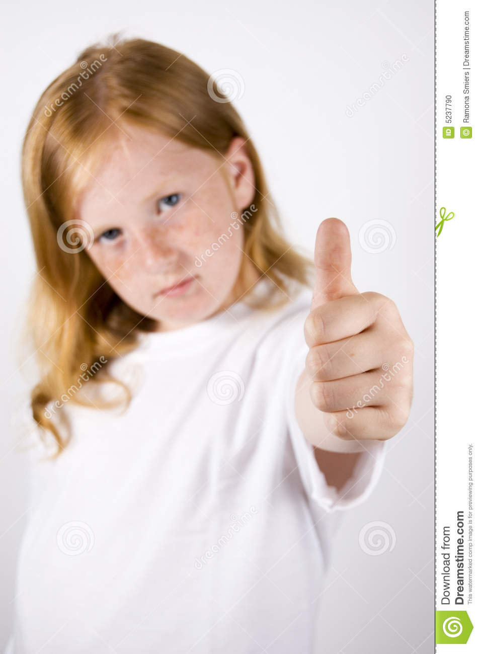 Cute Little Girl With Thumb Up Stock Photo