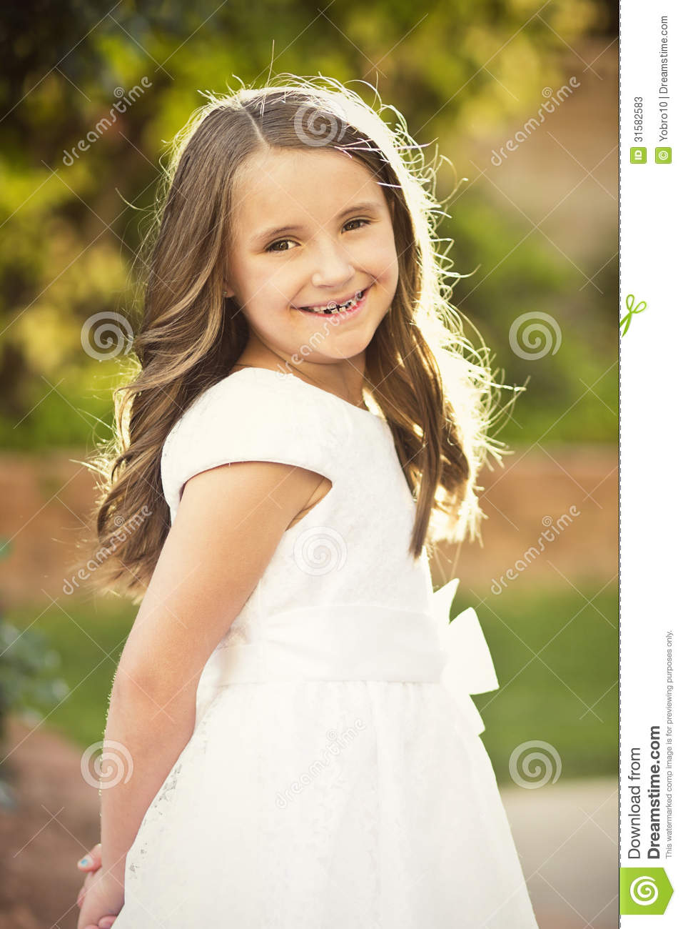 cute little girl wearing a white dress stock image - image of child