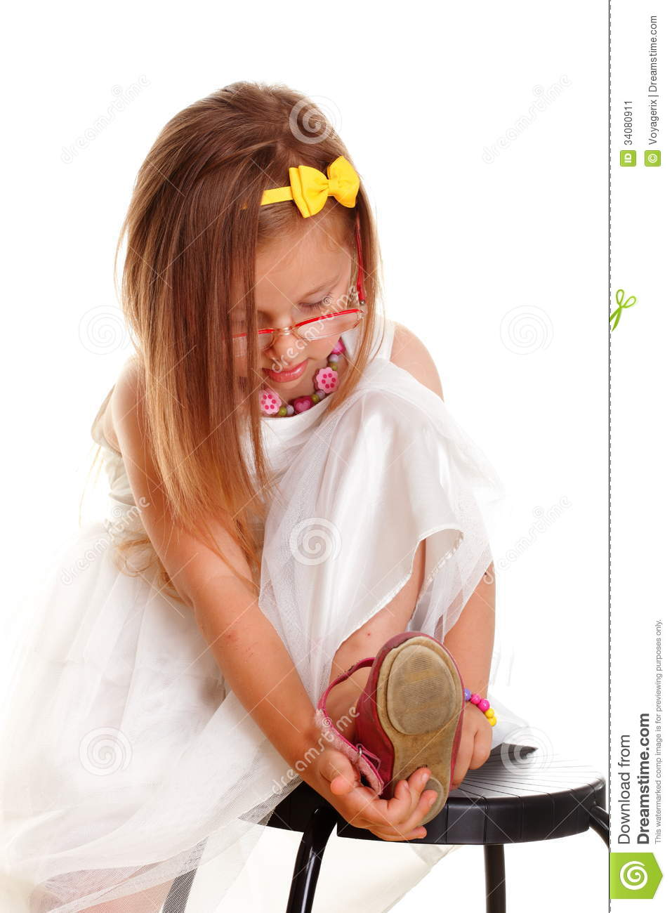 Cute Girl Putting On Her Shoe Royalty-Free Stock Image ...