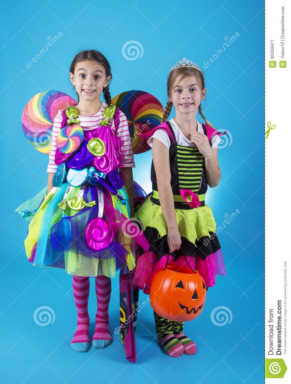 download cute little girls in halloween costumes ready to go trick or treating stock image
