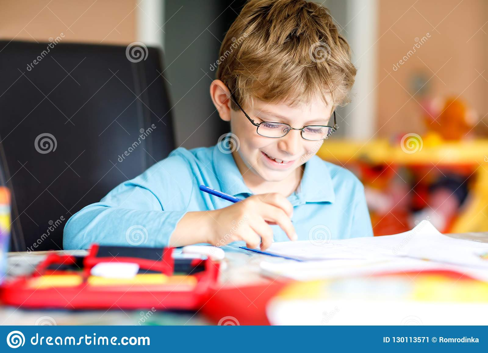 9eb28064818 Cute Little Kid Boy With Glasses At Home Making Homework