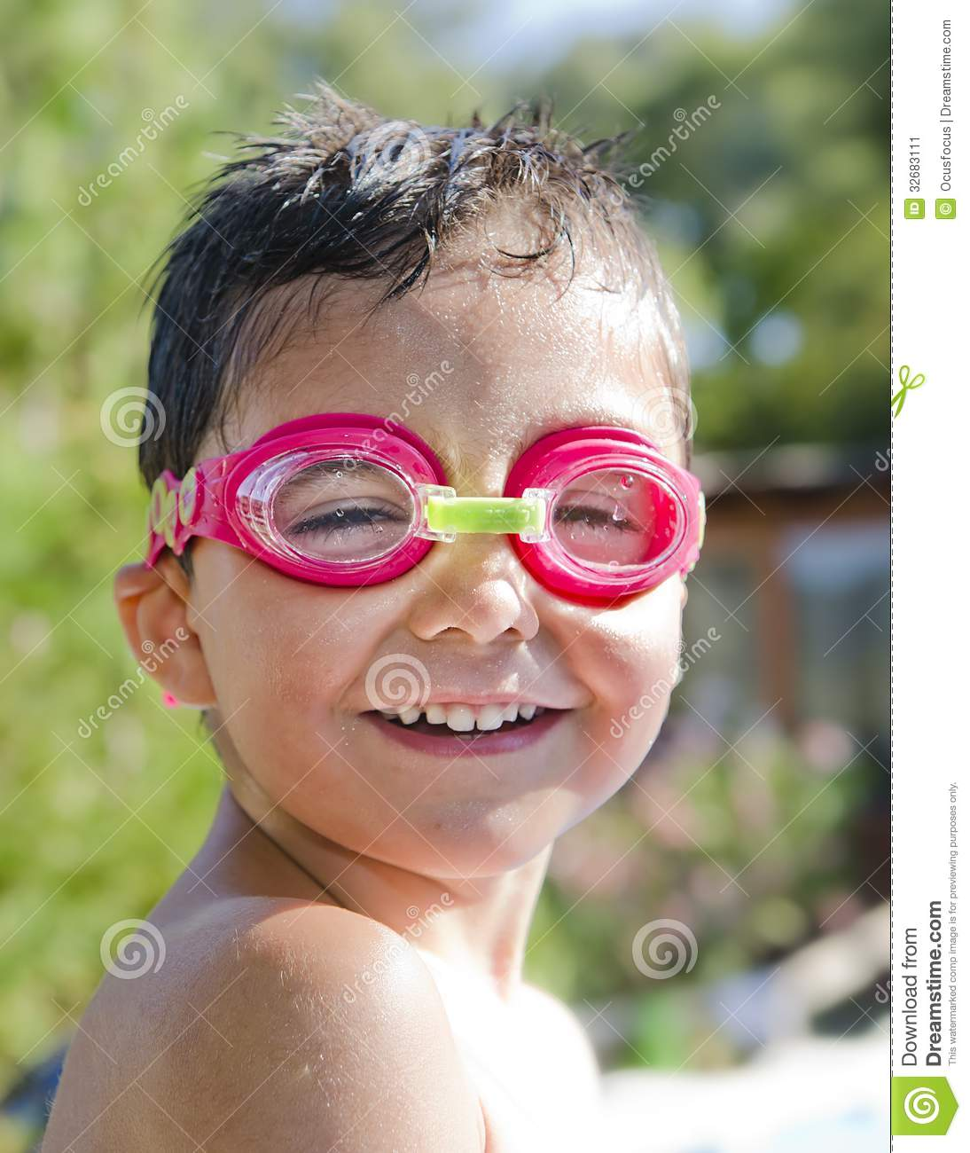 Cute Little Kid with Goggles laughing in Pool