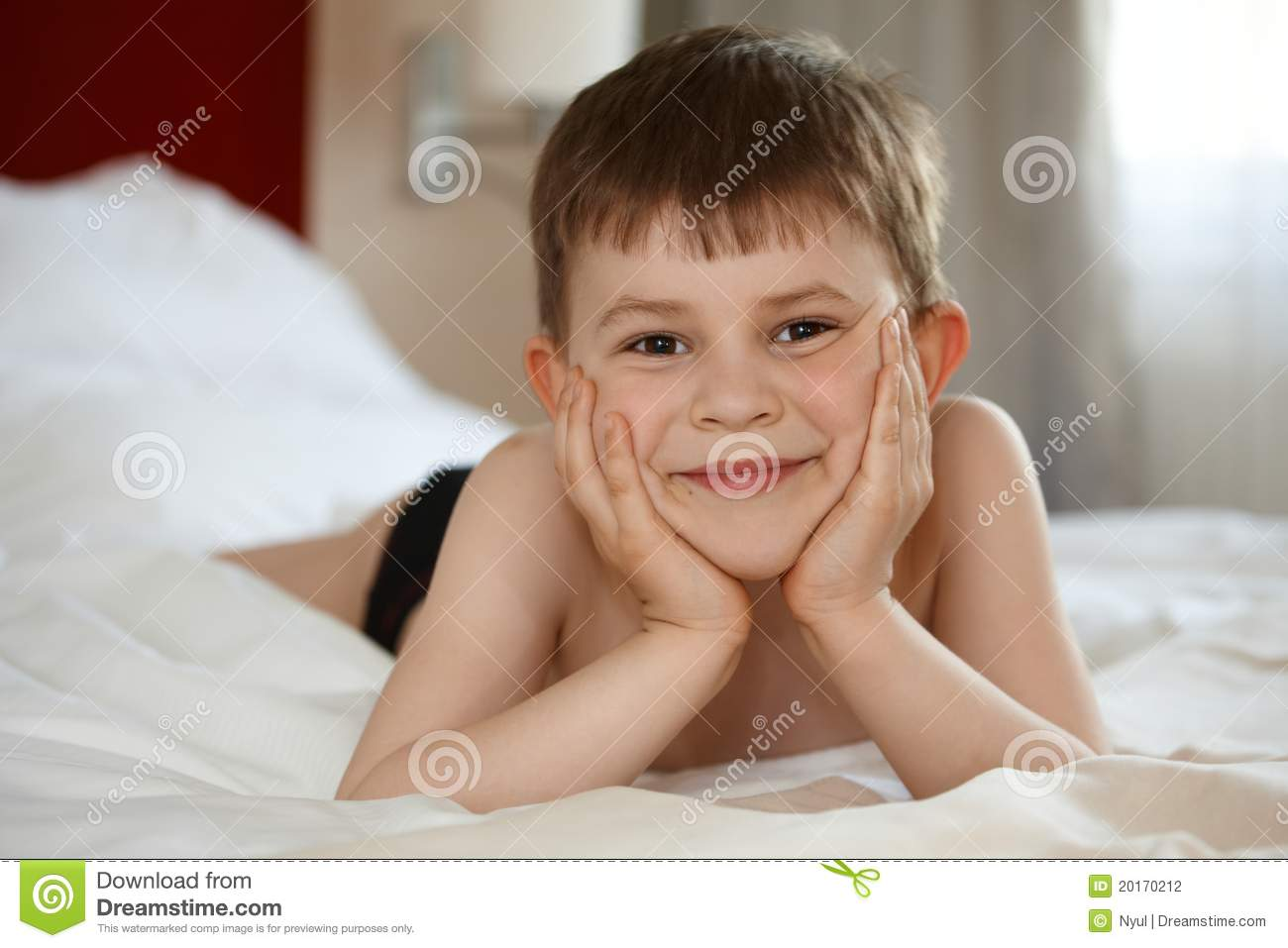 Cute Little Kid Smiling In Bed Stock Photography