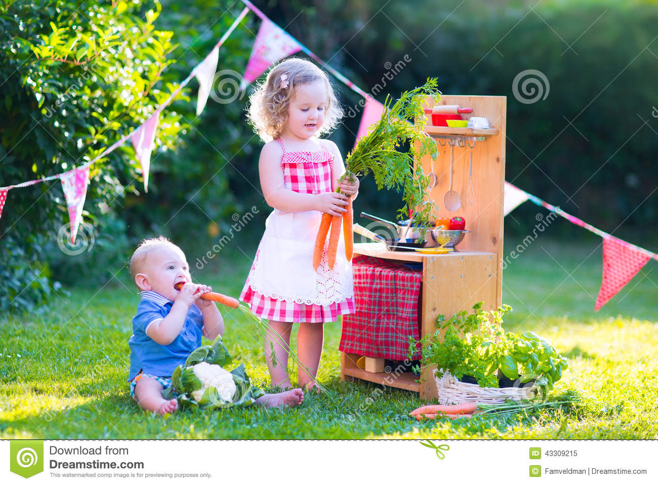 Cute Little Kids Playing With Toy Kitchen In The Garden
