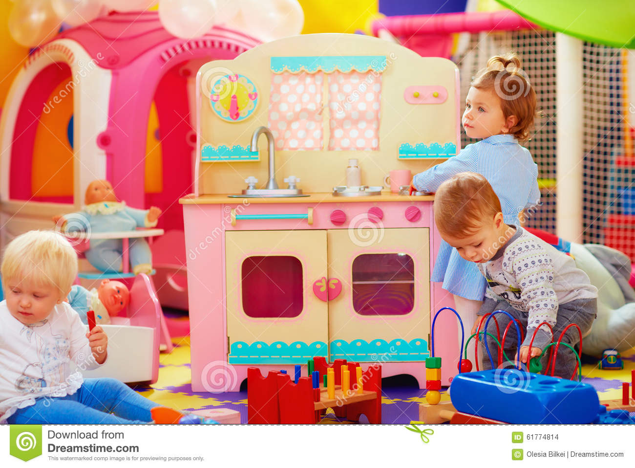 Kinder Garden: Cute Little Kids Playing With Toys In Nursery Group Of