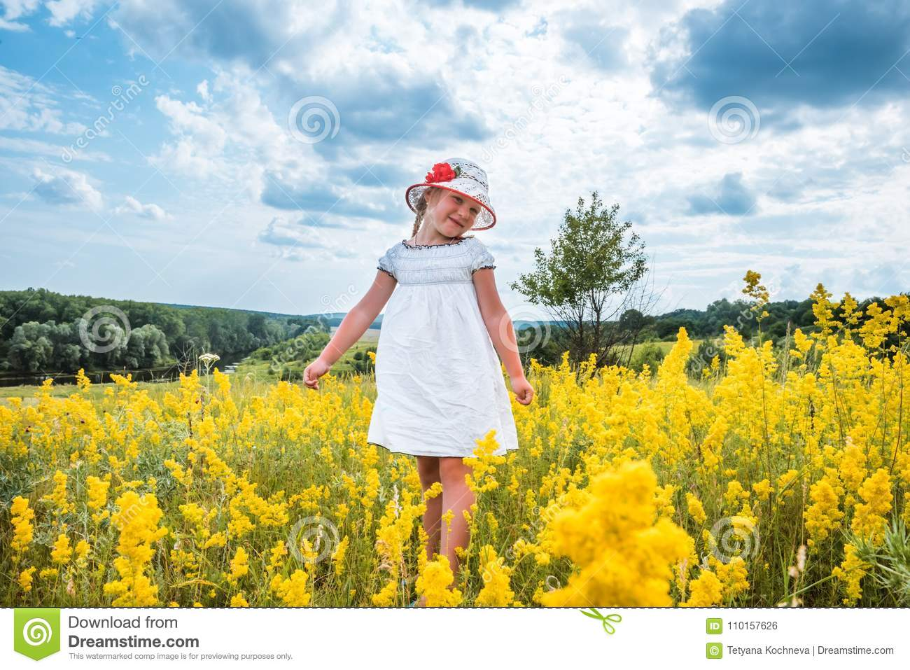 Cute little laughing girl walking in field of yellow flowers stock download cute little laughing girl walking in field of yellow flowers stock photo image of mightylinksfo