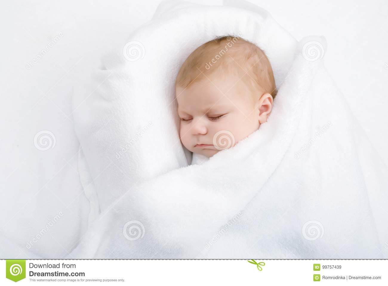 Cute Little Newborn Baby Girl Sleeping Wrapped In Blanket Stock