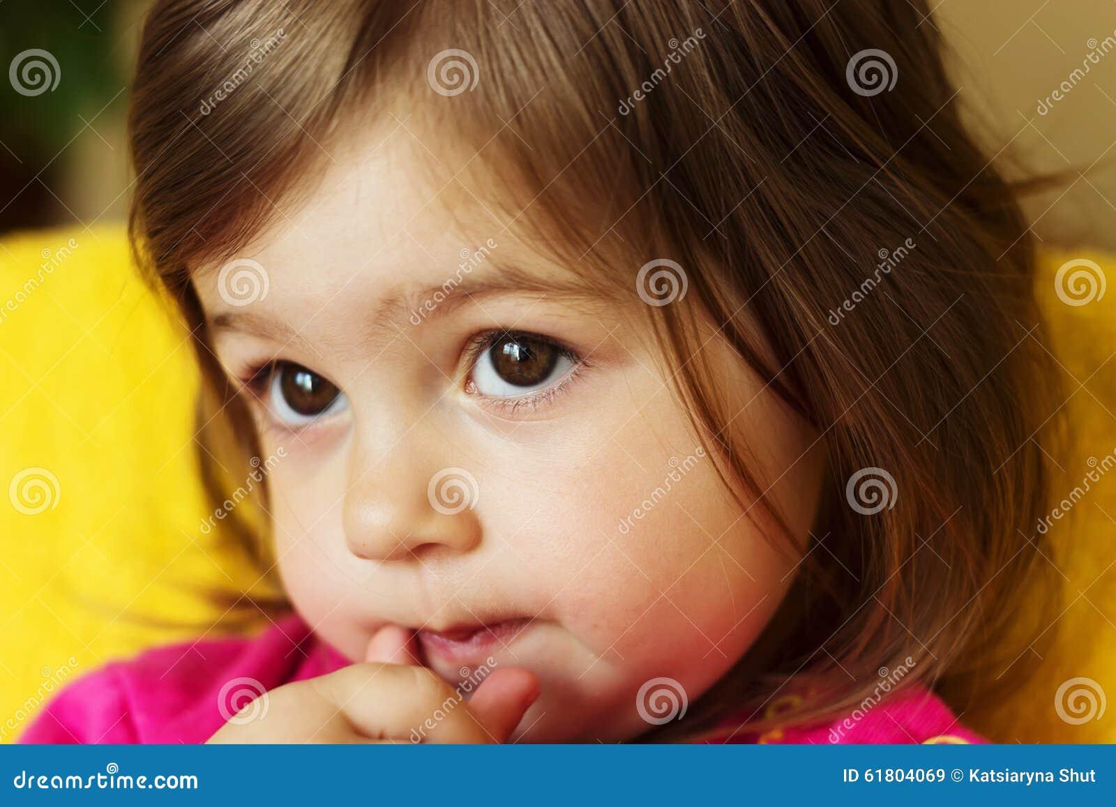 Cute little sad child thinking