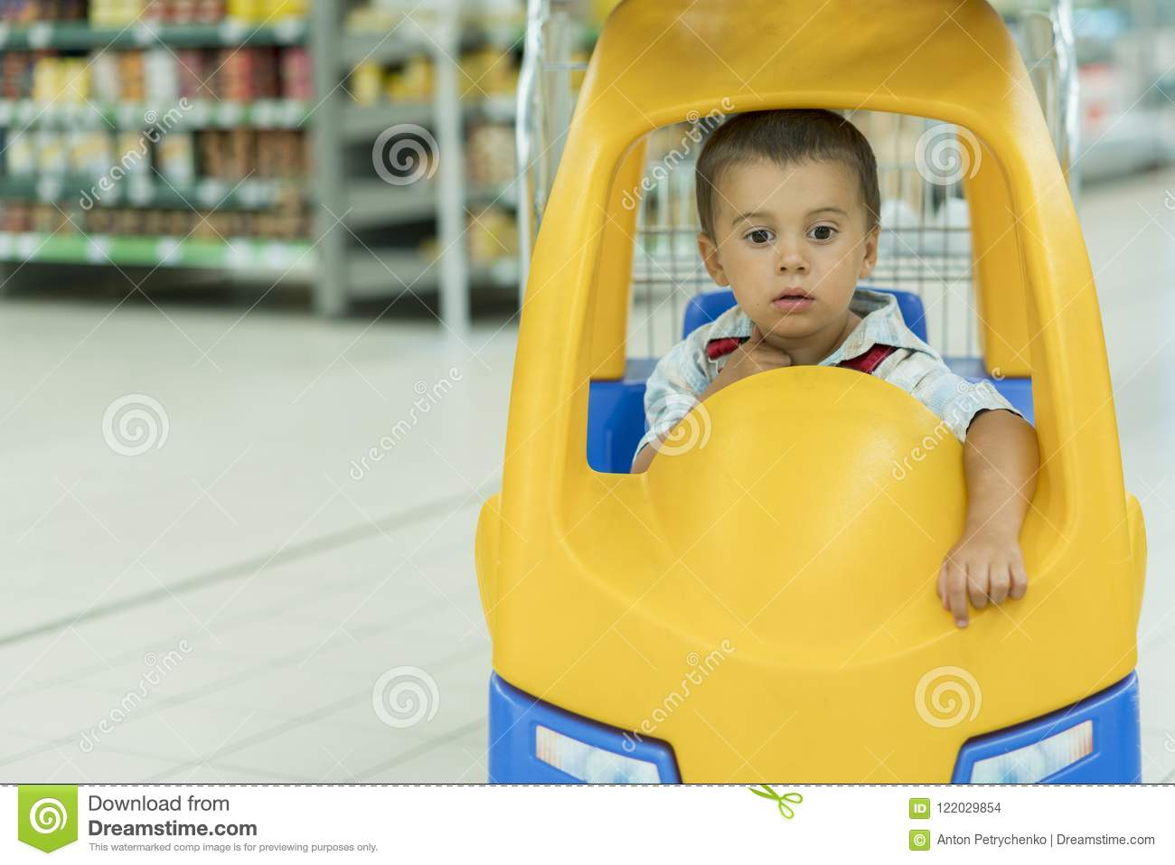 e3c072d02bf5 Cute Little 2 Year Old Baby Boy Child In The Little Toy-car Trolley ...