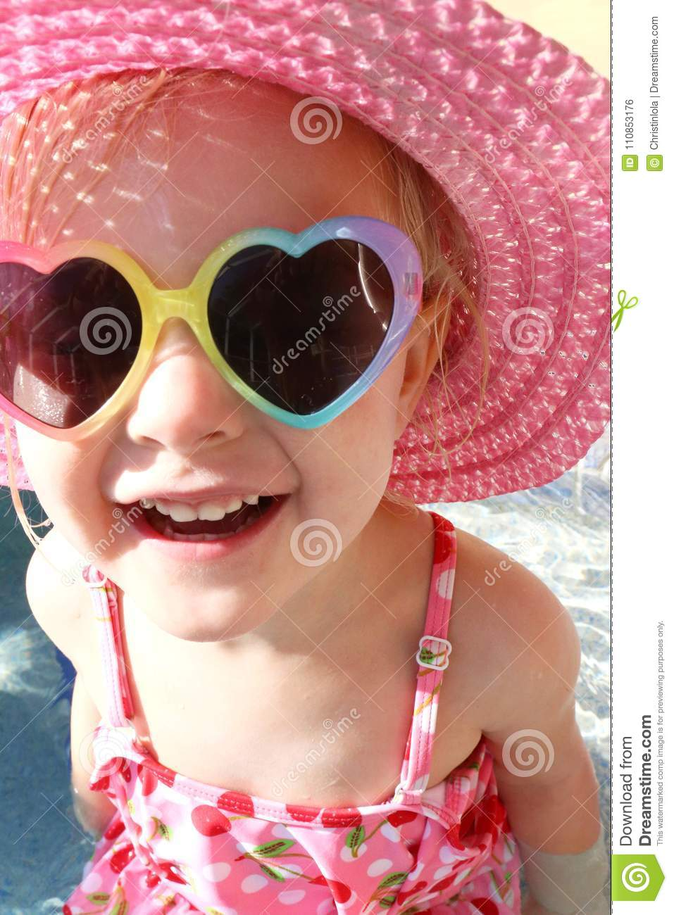 Happy Little Girl Laughing in Swimsuit, Sun Hat and Sunglasses