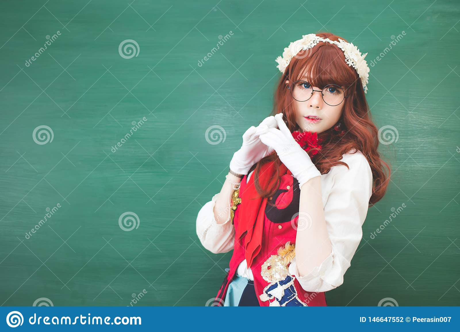 Cute long haired Asian girl Thai people wearing glasses and Japanese school uniforms standing in front of the blackboard.