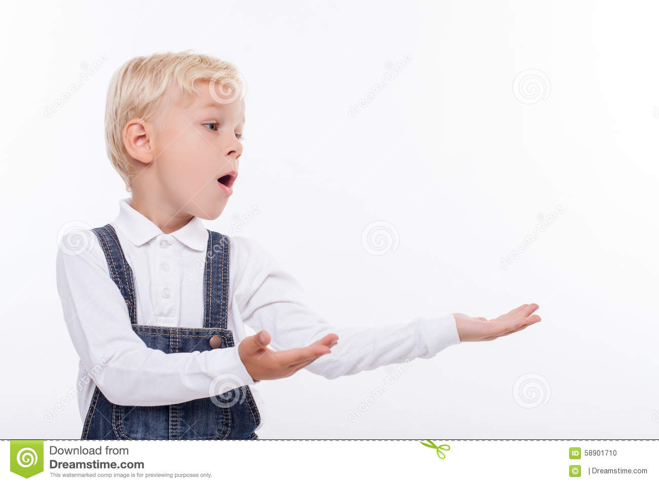Cute male child is presenting something with joy