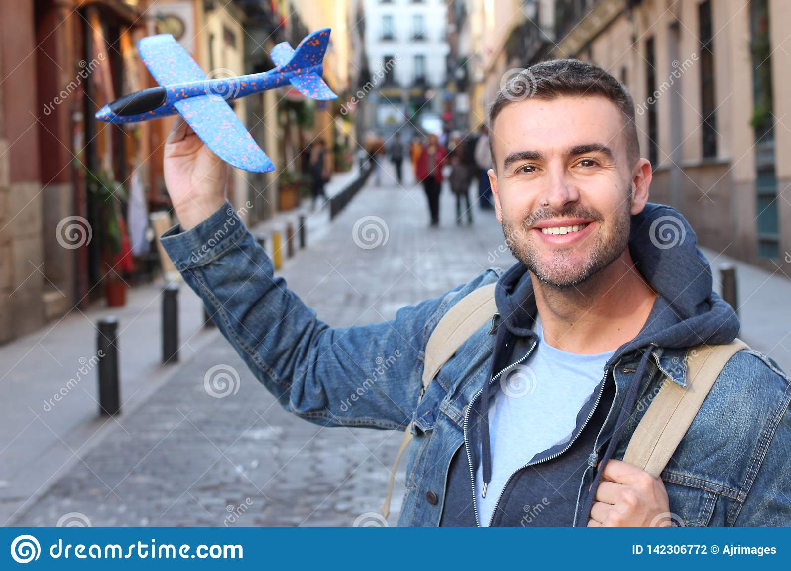 Cute man holding a toy airplane