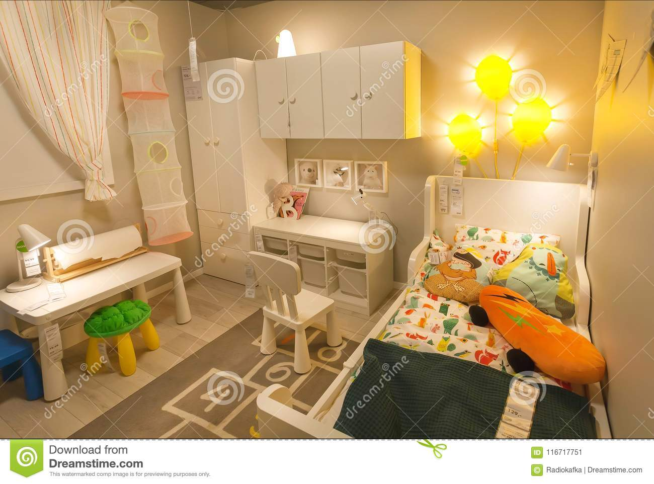 Cute modern children`s room in large ikea store with bed toys