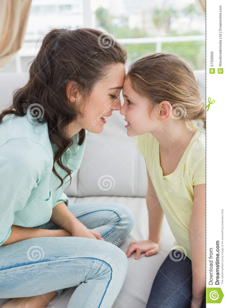Cute mother and daughter on the couch stock photo image for Mother daughter home plans