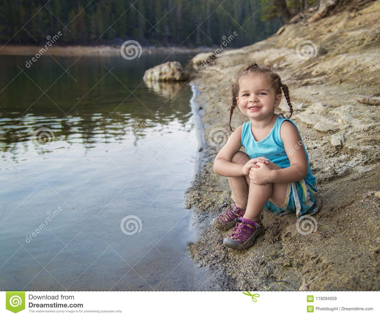 Adorable Little Girl Playing With Beach Toys During: Toddler Girl At Lake`s Edge Stock Image