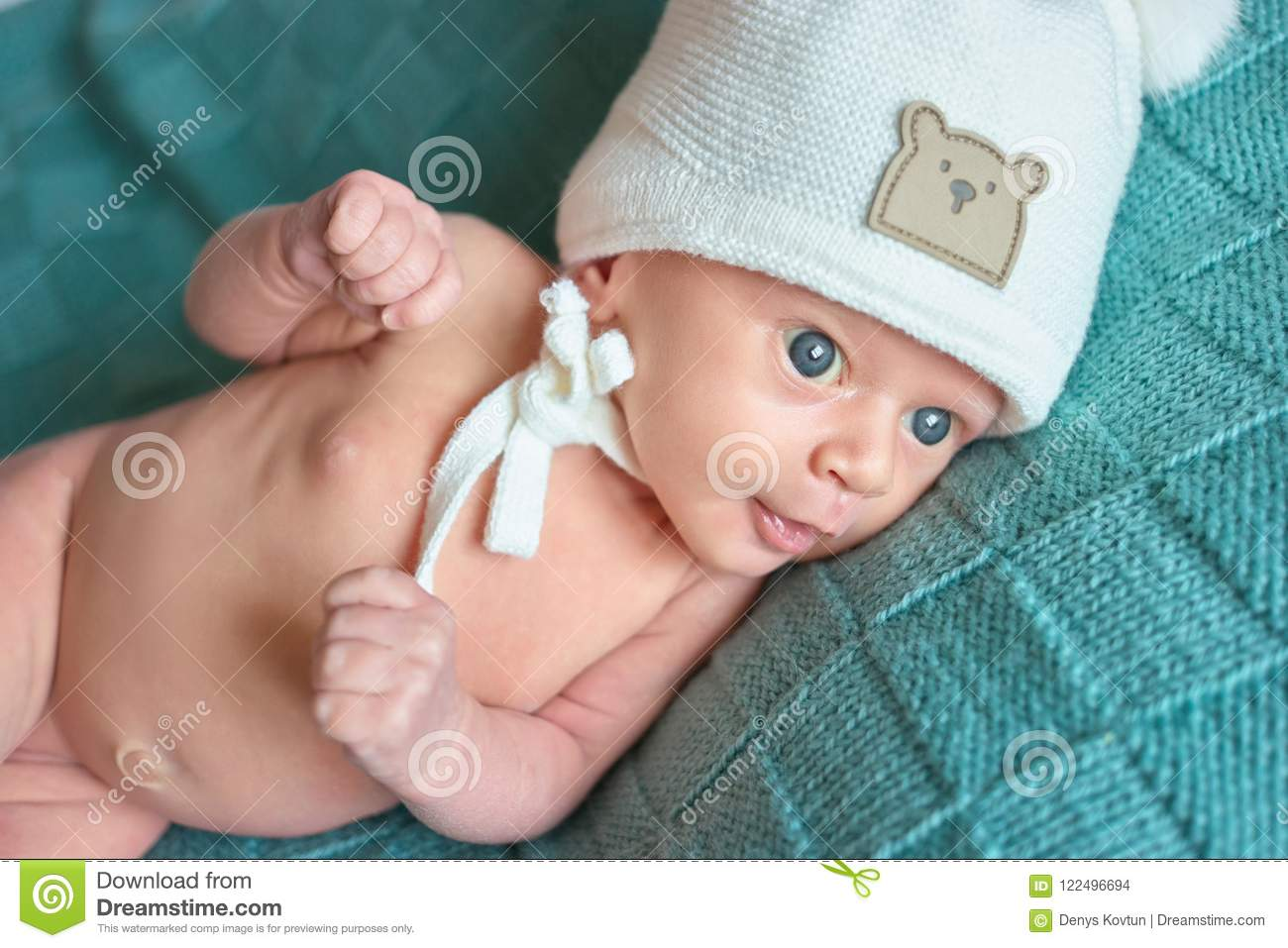 1cc066cbc897 Cute Naked Newborn Baby With White Woolen Hat. Stock Photo - Image ...