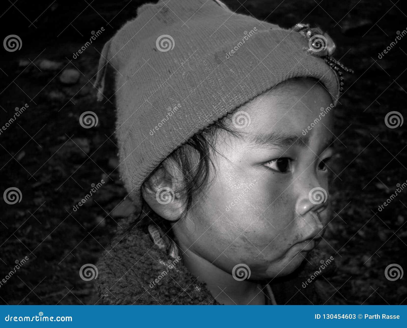 A Close up portrait of Nepal`s kid .