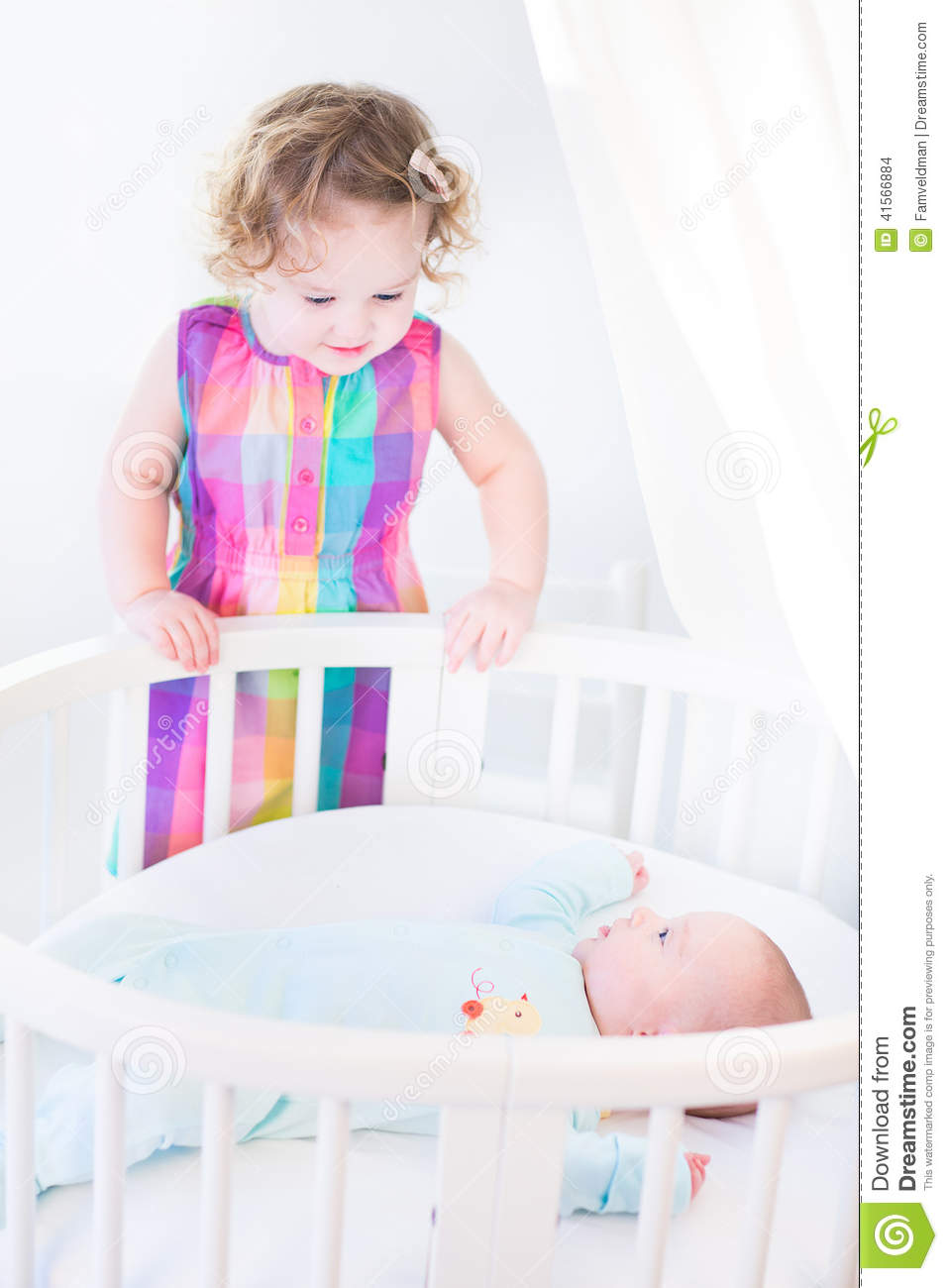 Cute Newborn Baby Boy Looking At His Toddler Sister Stock